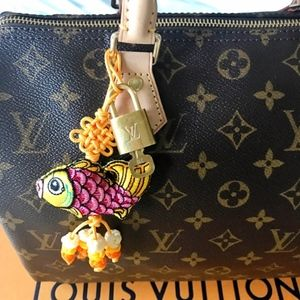 Louis Vuitton brass lock & key with bag Charm